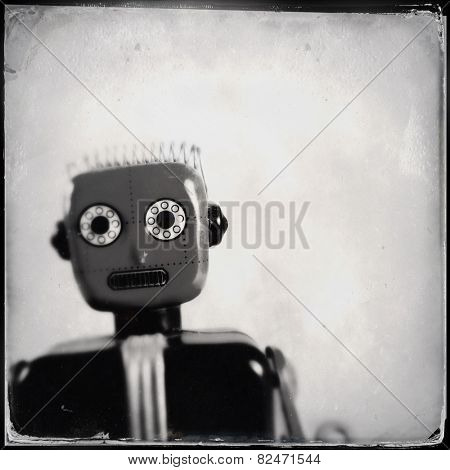 Instagram filtered image of an old toy robot