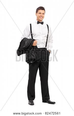 Full length portrait of an elegant man carrying his coat and posing isolated on white background