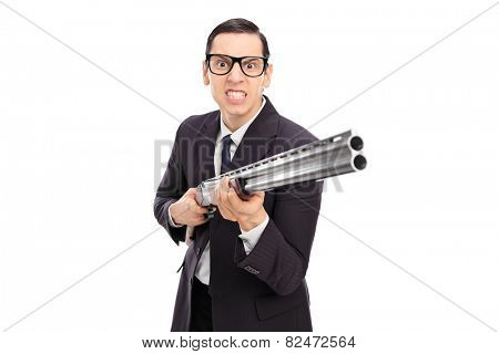 Angry businessman holding a shotgun isolated on white background