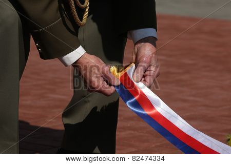 PRAGUE, CZECH REPUBLIC - MAY 9, 2013: Czech war veteran attends the celebration of Victory Day at the Soviet War Memorial at the Olsany Cemetery in Prague, Czech Republic.