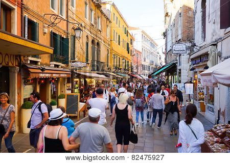 VENICE - SEP 14: people on street on September 14, 2014 in Venice, Italy. Venice is a city in northeastern Italy sited on a group of 118 small islands separated by canals and linked by bridges