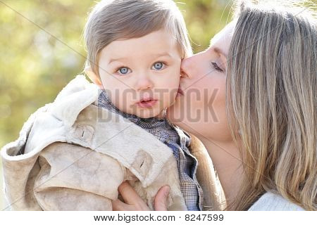 Family: Mother Kissing Baby Son