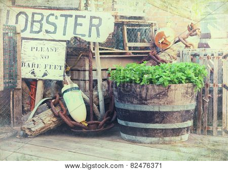 Image of lobster pots, buoys and fishing equipment on the quayside. Bar Harbor, Maine, United States.