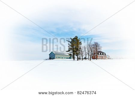 Farmhouse and farm buildings, minimalistic winter snow scene with white vignette. Beauce region of Quebec, Canada