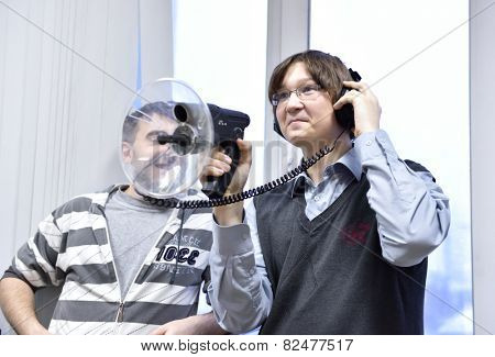 NOVOSIBIRSK, RUSSIA - JANUARY 15, 2015: Student use the directional microphone in the laboratory of information security of the Novosibirsk State University of Economics and Management