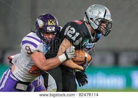 INNSBRUCK, AUSTRIA - JULY 6 DB Markus Krause (#21 Raiders) is tackled by DB Peter Tutsch (#9 Vikings)at Euro Bowl XXVII on July 6, 2013 in Innsbruck, Austria.