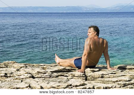 man sitting on rocks