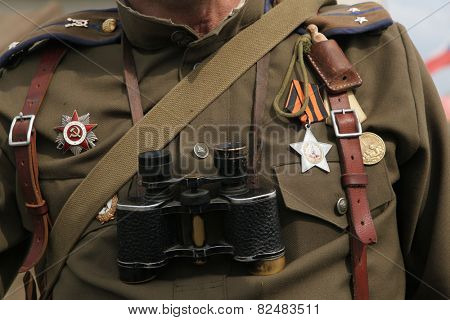 ORECHOV, CZECH REPUBLIC - APRIL 27, 2013: Soviet military decoration on the uniform of a Soviet soldier seen during the re-enactment of the Battle at Orechov (1945) near Brno, Czech Republic.