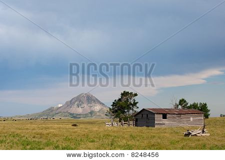 Old Barn With Butte In Background