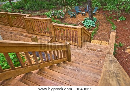 Wood Stairway To Landscaped Yard