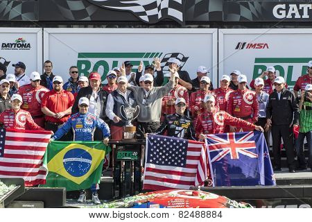 Daytona Beach, FL - Jan 25, 2015:  The Chip Ganasi Racing with Felix Sabetes Riley DP crew celebrates after winning the Rolex 24 at Daytona International Speedway in Daytona Beach, FL.