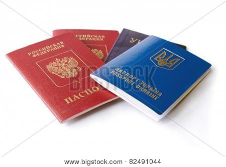 Ukrainian and Russian ID passports isolated on white background, means conflict between two countries