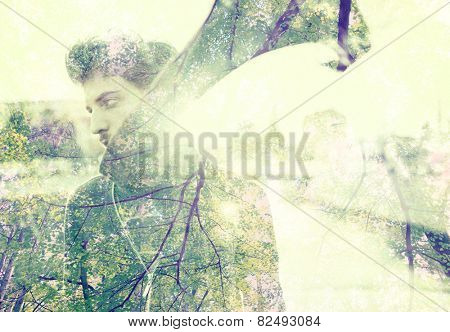 Young attractive man in real authentic life on city street with double exposure