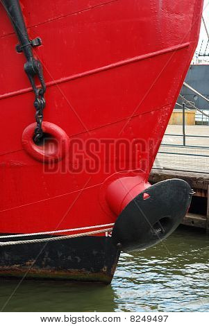 Front view of a red ship