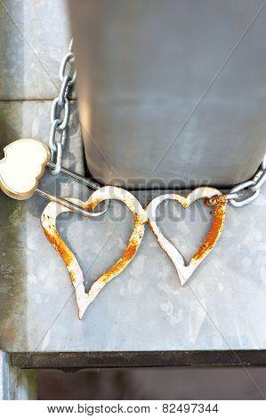 Pair Metal Love Hearts With Lock On Bridge. Wedding Tradition.