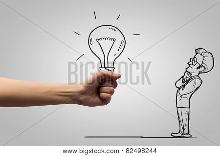 Human hand and caricature of funny thoughtful man