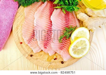 Tilapia with ginger and lemon on board