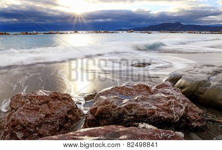 Beach Scape With Stormy Clouds At The Horizon