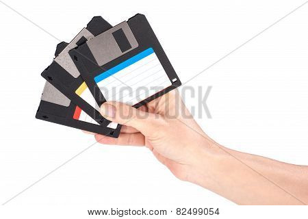 Female Hand Holding Floppy Disks