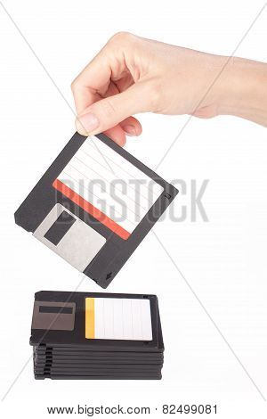 Female Hand Takes A Floppy Disk
