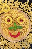 image of smiley face  - Pasta smiley face abstract background on a wooden board - JPG
