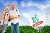 stock photo of shoulder-blade  - Happy tourist couple using the guidebook against cloud heart - JPG