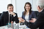 stock photo of conversation  - Three entrepreneurs during business conversation - JPG