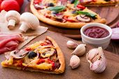 Постер, плакат: Pizza with seafood on wood table
