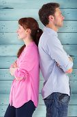 picture of irritated  - Irritated couple ignoring each other against wooden planks - JPG