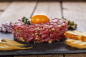 stock photo of tartar  - Beef tartare with capers and onions yolk with mustard