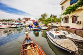 stock photo of life-boat  - Fishing boats in port at Phu Quoc island - JPG
