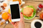 picture of breakfast  - breakfast and mobile phone on wooden table - JPG