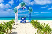 foto of wedding arch  - beautiful decorated wedding arch on sand beach - JPG