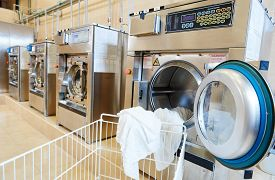 image of laundromat  - line of industrial laundry machine in laundrette - JPG