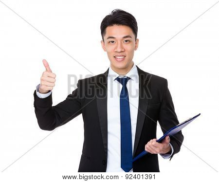 Businessman hold with clipboard and thumb up
