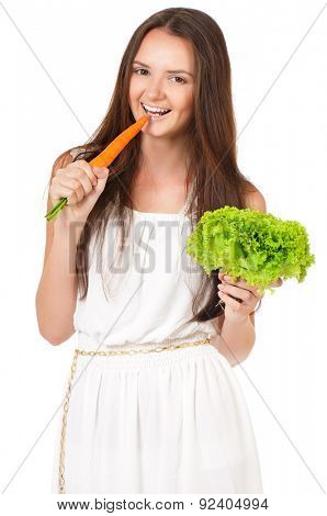 Happy beautiful girl with fresh carrots and lettuce, isolated on white background