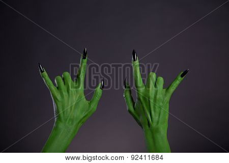 Green monster hands showing heavy metal gesture, Halloween theme
