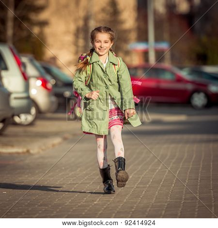 happy little girl go home from school