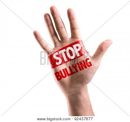 Open hand raised with the text: Stop Bullying isolated on white background