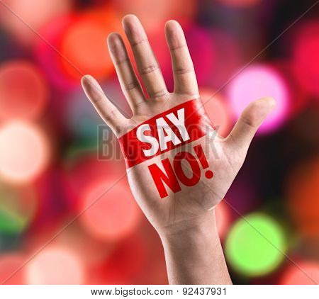 Open hand raised with the text: Say No! with bokeh background