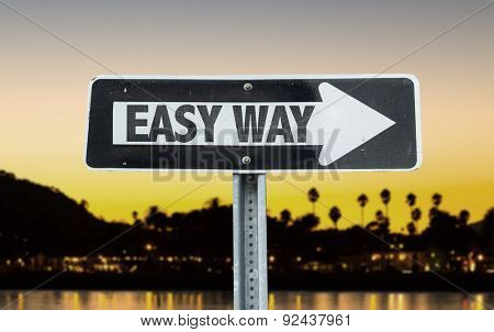 Easy Way direction sign with sunset background