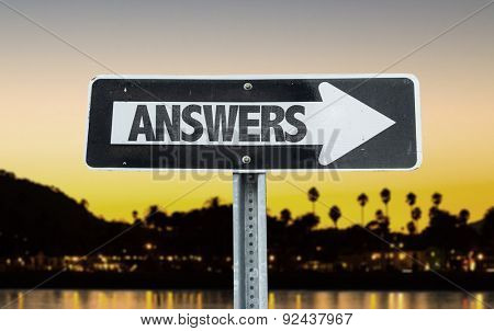 Answers direction sign with sunset background