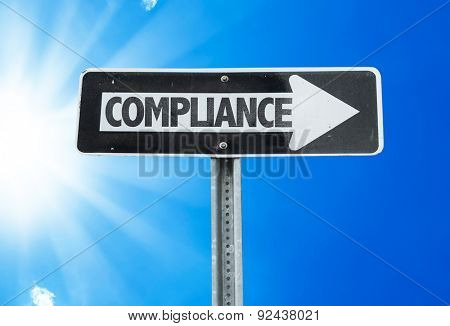 Compliance direction sign with a beautiful day