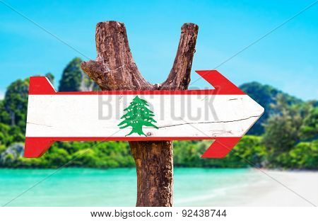 Lebanon Flag wooden sign with coast background