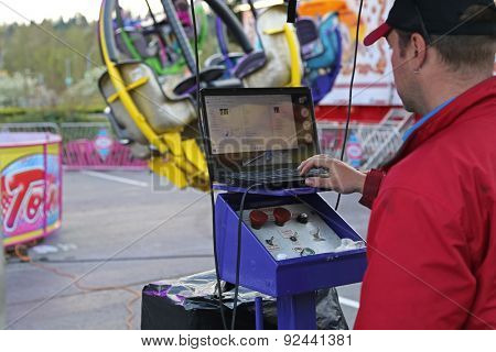 Coquitlam, BC, Canada - April 09, 2015 : Worker control the machine at the West Coast Amusements Carnival