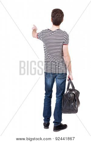 back view of  pointing man  with bag.  backside view of person.  Rear view people collection. Isolated over white background.  The guy with the bag is fashionable and shows thumb.