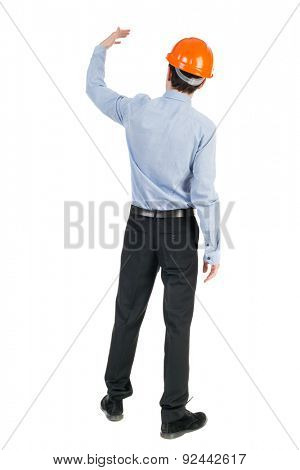Backview of an engineer in construction helmet stands. Standing young guy. Rear view people collection.  backside view of person.  Isolated over white background. Engineer beckons to her employee.