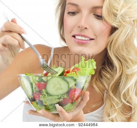 portrait of attractive  caucasian  woman isolated on white studio shot eating salat