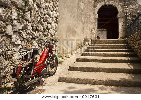 Moped By City Walls