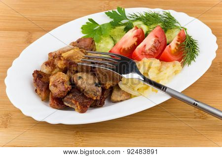 Fried Pork And Onions With Tomatoes, Cucumbers And Greens